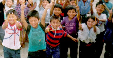 Photo of happy school children in San Juan la Laguna, happy because they have been given 3 pencils each